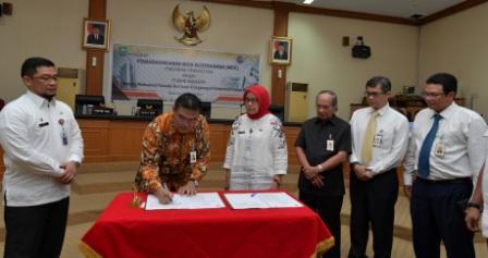 Pemprov Riau dan Bank Riau Kepri Teken MoU Implementasi Transaksi Non Tunai