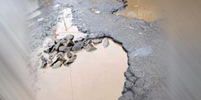 Gunakan Dana APBN 2014, Jalan Nasional di Pangkalankuras Mulai Hancur