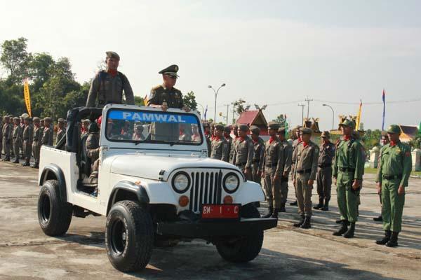 Bupati Pelalawan HM Harris Minta Satpol PP Tegakan Perda Tegas dan Santun